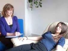 Hypnotherapist with a client